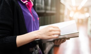 Woman reading new library book