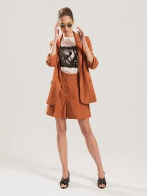 Model wears blazer, £49.50, and shorts, £27.50, both marksandspencer.com. T-shirt, £85, coach.com. Sandals, £79, stories.com. Sunglasses, £205, articleoneeyewear.com