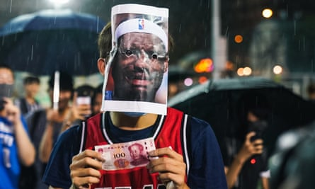 A protestor in Hong Kong wears a LeBron James mask after the NBA star's comments sparked a backlash