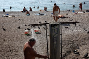 People enjoy warm weather on an Athens beach