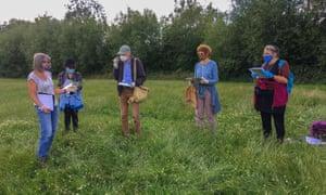 Volunteers taking part in a community botanical survey workshop