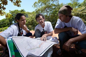 Three of the participants of the expedition check a map and possible routes for the fieldwork.