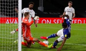 Fulham keeper Marek Rodak saves at close range from Nathaniel Mendez-Laing of Cardiff City.