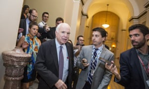 McCain leaves the Senate chamber after voting against 'skinny repeal' of the Affordable Care Act in July 2017.
