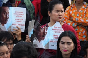Boeng Kak community land rights activists in Phnom Penh, Cambodia, hold up a poster of environmental activist Chut Wutty
