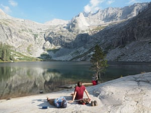 Resting and soaking up sublime mountain scenery beside the largest of Hamilton Lakes, High Sierra Trail , Sierra Nevada