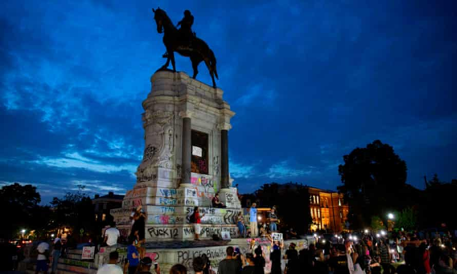 A crowd gathers at the Robert E. Lee statue on Monument Avenue in Richmond, during the continued protests on Thursday.