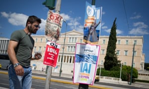 A man walks past No and Yes posters in front of the Greek parliament in Athens on 4 July 2015.