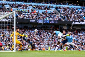 Raheem Sterling from Manchester City scores.