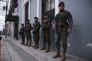 Soldiers stand guard near Guatemala's congress building.