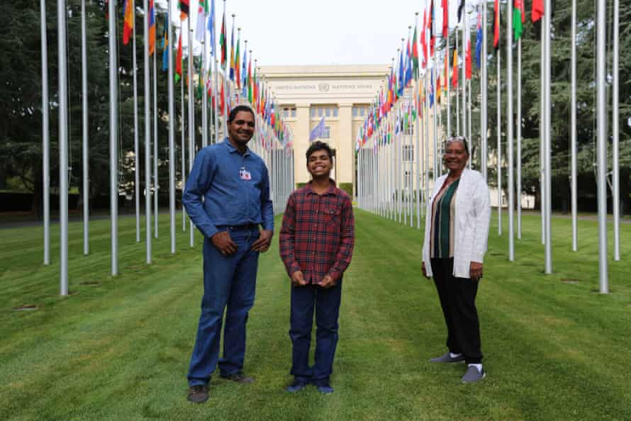 Dujuan Hoosan with his father (l), James Mawon, and grandmother (r), Margaret Anderson, in front of the United Nations building in Geneva.