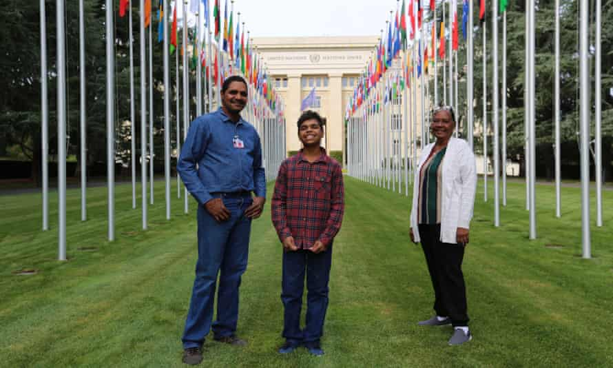 Dujuan Hoosan, his father James Mawon and grandmother Margaret Anderson at the UN building in Geneva.