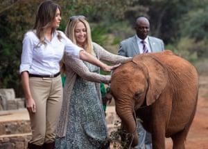 Trump meets a young elephant at the David Sheldrick Elephant Orphanage in Nairobi