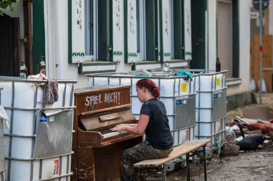 Elisabeth Parschaun plays her piano in the street