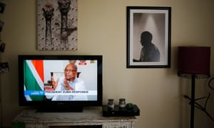 The South African president, Jacob Zuma, appearing on state TV with a portrait of Nelson Mandela to the right of the picture