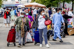 Shoppers wear mandatory face masks while in public during the coronavirus outbreak in Antwerp, Belgium, on 29 July 2020.