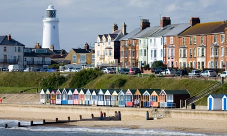 Lighthouse and beach huts at Southwold, Suffolk.