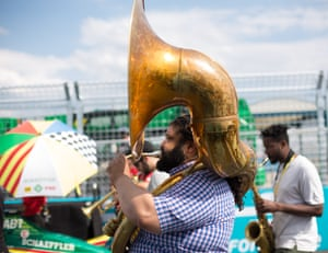A New Orleans-style brass band plays ahead of the race