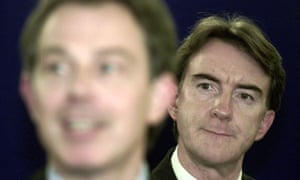 Peter Mandelson listens to a speech by Tony Blair in 2001.