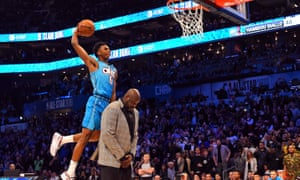 Oklahoma City Thunder forward Hamidou Diallo leaps over Shaquille O'Neal in the NBA slam dunk contest