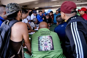 Coaches from different gyms review the lists to place boxers in fights as appropriate for their weight and age