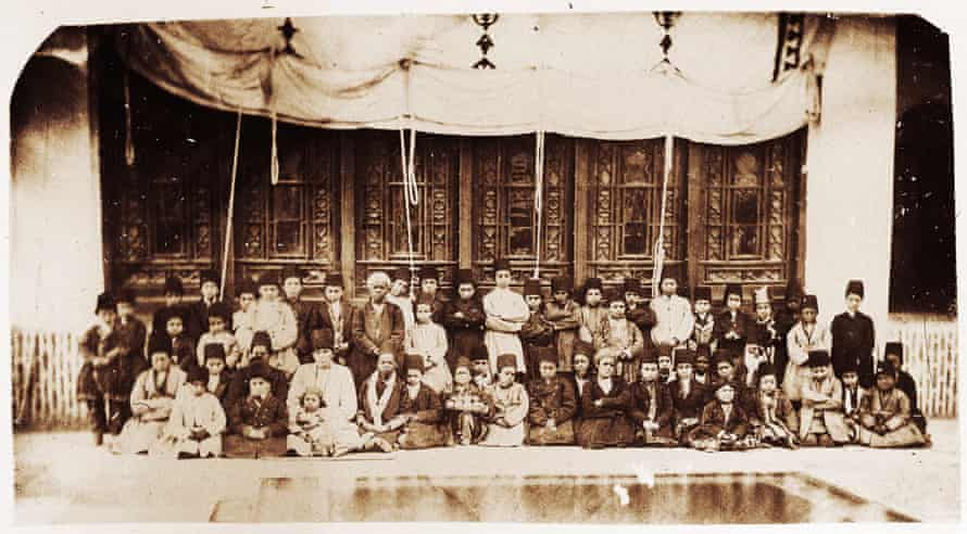 Nasser al-Din Shah had a special interest in taking photos of his own slaves inside the harem. In this photo, 53 eunuch slaves of different ethnic backgrounds in their early childhood, had probably been recently sent from abroad to the local southern markets, and to the king's harem. Among them four African boys (qolam bachehha), inside Nasser al-Din Shah's harem, Golestan Palace, Tehran. Date unknown.