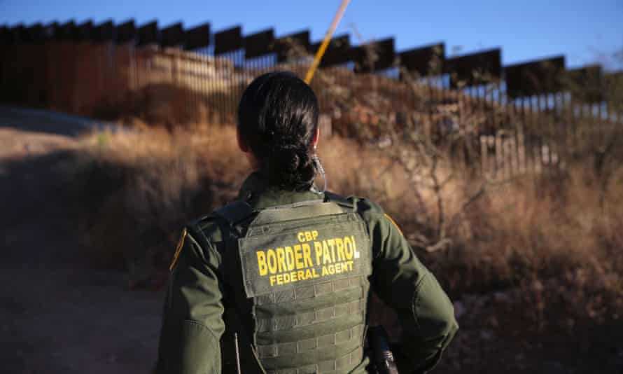 US Border Patrol agent Nicole Ballistrea watches over the US-Mexico border fence