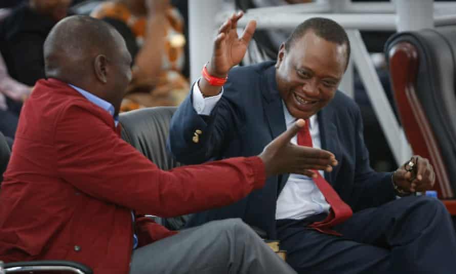 Kenya's incumbent President Uhuru Kenyatta (R) and his running mate William Ruto (L) joke around during a Sunday church service.