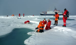 AWI scientists sample a melt pond on Arctic sea ice, discovering record levels of microplastics.