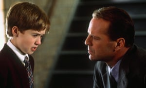 Haley Joel Osment and Bruce Willis in The Sixth Sense. M Night Shyamalan's film was – and remains – unclassifiable.