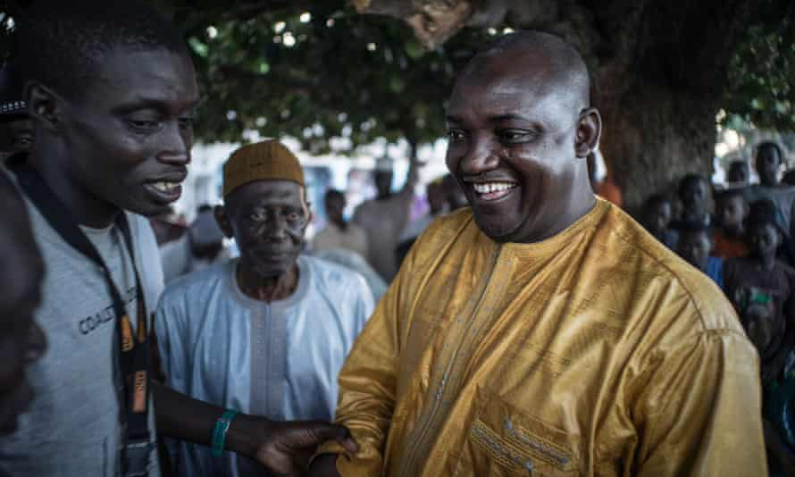 Adama Barrow is greeted by supporters in Jambur.