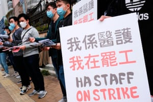Medical workers hold a strike near Queen Elizabeth Hospital, demanding Hong Kong close its border with China to reduce the coronavirus spreading.