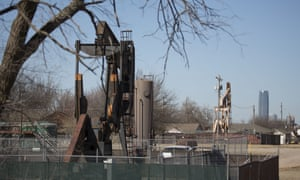 Oil field pumping rigs stand in an Oklahoma City neighbourhood. Many believe the injection into deep underground wells of fluid byproducts from drilling operations is causing earthquakes.