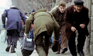 Residents of Sarajevo run for cover