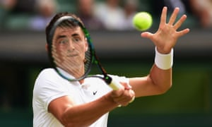 Bernard Tomic plays a forehand but is struggling against Novak Djokovic .