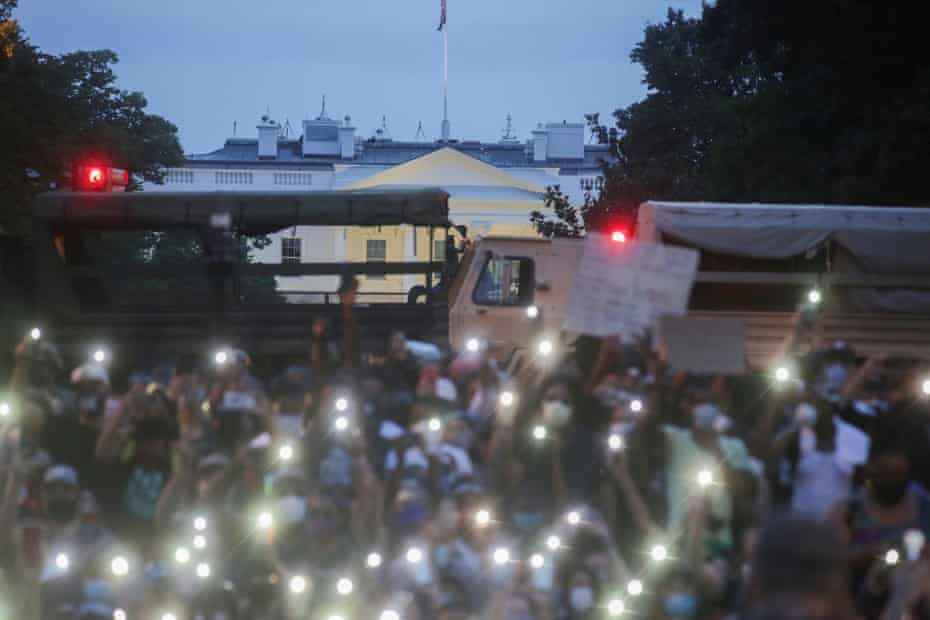 Protest against the death in Minneapolis police custody of George Floyd, in WashingtonDemonstrators use the light of their cellphones as they gather during a protest against the death in Minneapolis police custody of George Floyd, near the White House in Washington, U.S., June 3, 2020.