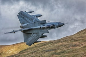 Magnificent Tonka  Amateur photographer, second prize.  Taken on the Mach Loop from Cad West, a Tornado GR4 demonstrates its manoeuvrability through the valleys.