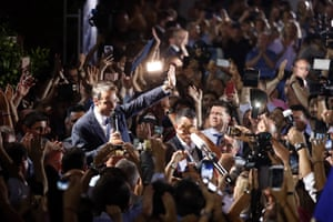 Kyriakos Mitsotakis waves to his supporters after winning the parliamentary election