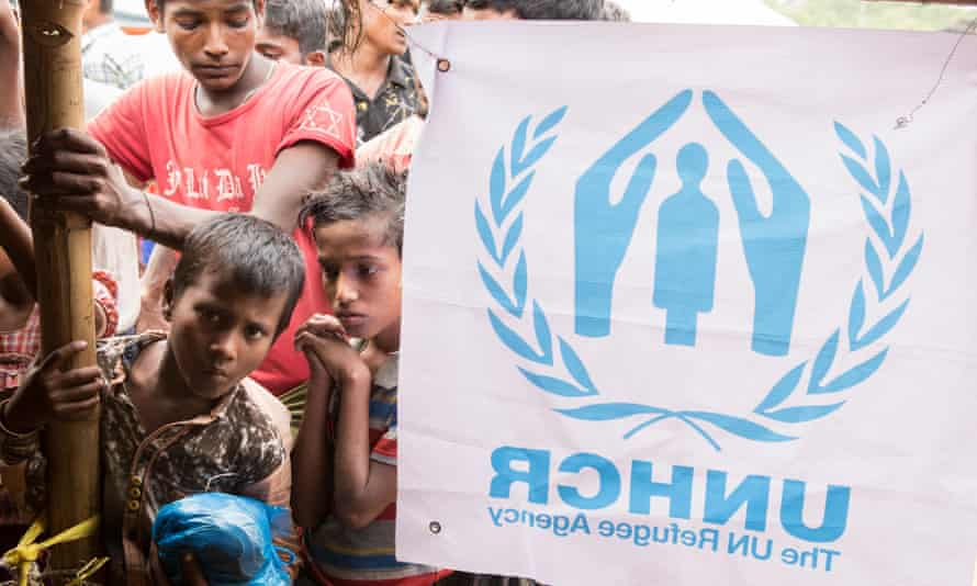 People wait to be registered in a UNHCR distribution centre in Kutupalong camp.