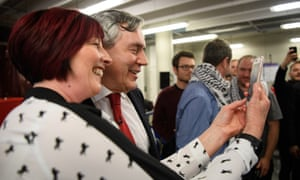 Gordon Brown posing for a selfie at a Labour rally in the Engineering Building of Coventry University, where he delivered a speech.