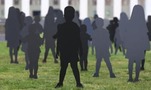Save the Children and Amnesty International Australia set up silhouettes on the lawns of Parliament House, Canberra, to represent asylum seeker children held on Nauru.