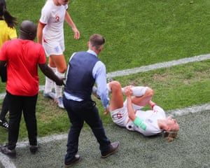 Steph Houghton lies injured against Cameroon.