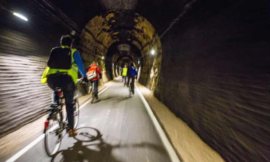 Cyclists enjoy riding through the restored Devonshire Tunnel which is part of the Two Tunnels Greenway near Bath