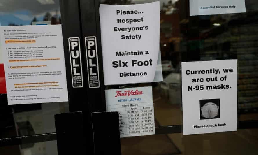 Signs remind customers of coronavirus orders at a harware store in Orinda, California.
