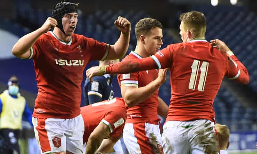 Wales players celebrate their victory over Scotland