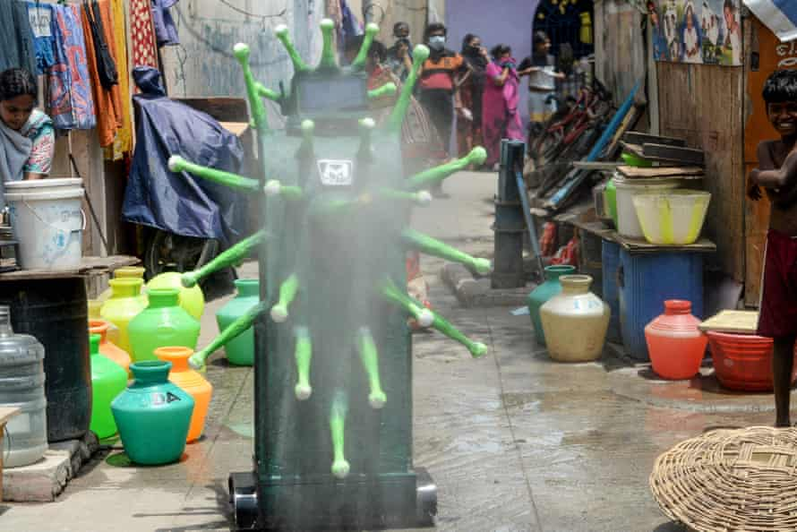 A Covid-themed robot sprays disinfectant in Chennai, Tamil Nadu.