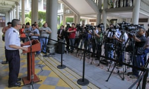 The director of the national police announces the arrest of police and government officials in San Salvador on Wednesday.