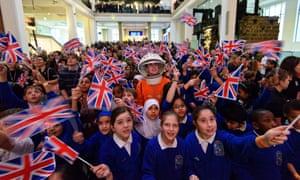 School waving flags as Tim Peake goes into space