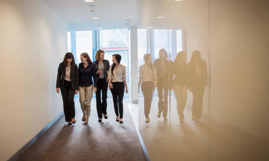 Businesswomen walking in a row in office