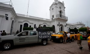 Navy and civil protection vehicles are seen outside the city hall in Escuinapa, Sinaloa state, on 22 October.